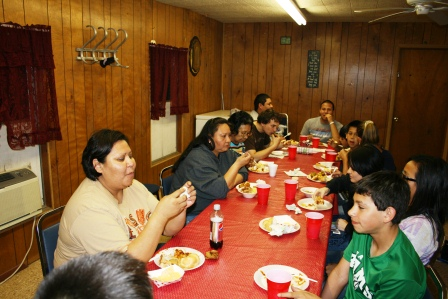 A photo of local believers eating together
